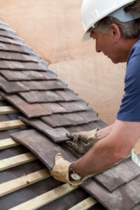 Construction Site Roofer Laying Roof Tiles